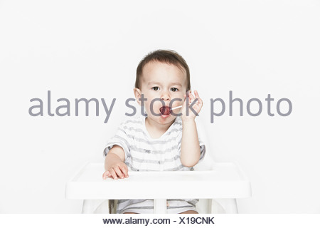 Baby boy with lollipop - Stock Photo