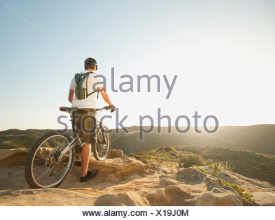 USA, California, Laguna Beach, Mountain biker on top of hill - Stock Photo