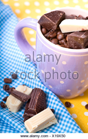 Cup with coffee beans and chocolate - Stock Photo
