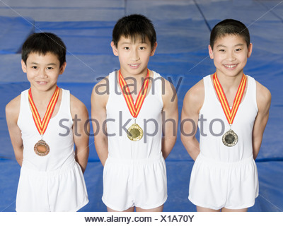 Young gymnasts with medals - Stock Photo