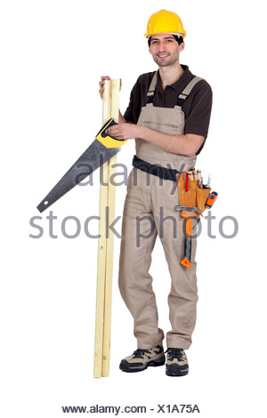 Worker holding plank - Stock Photo