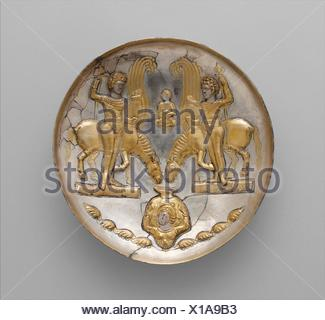 Plate with youths and winged horses. Period: Sasanian; Date: ca. 5th-6th century A.D; Geography: Iran; Culture: Sasanian; Medium: Silver, mercury - Stock Photo