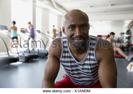 Close up portrait smiling man at gym - Stock Photo