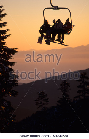 Riding the Sunshine Chair at Cypress Bowl Ski Resort, West Vancouver, British Columbia, Canada. - Stock Photo