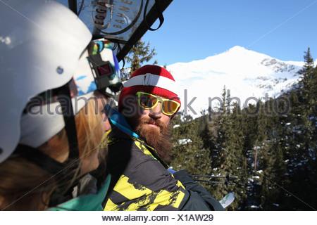 Snowboard and skiing couple on mountain, Mayrhofen, Tyrol, Austria - Stock Photo