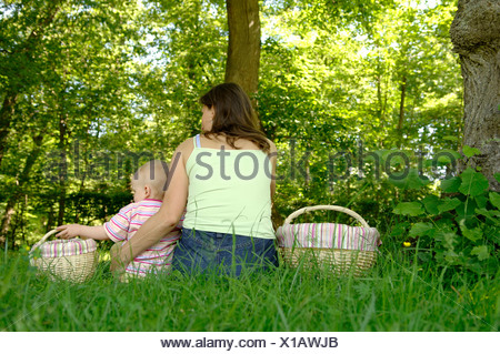 Mother and children in a green countryside - Stock Photo