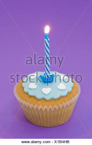 candle cake pie lit birthday cup blue food aliment sweet coloured colourful - Stock Photo