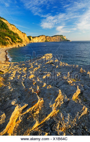 Limestone along the Atlantic shoreline at sunrise Forillon National Park Quebec Canada - Stock Photo