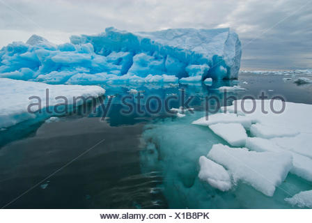 Magnificent icebergs seen above and below the water's surface. - Stock Photo