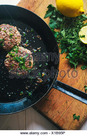 Meat frying in pan - Stock Photo