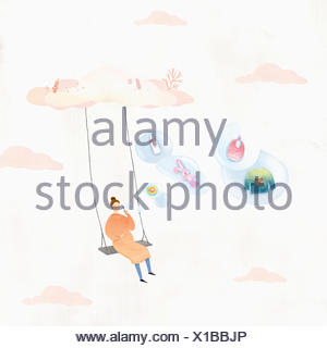 Pregnant woman sitting on a swing blowing bubbles - Stock Photo