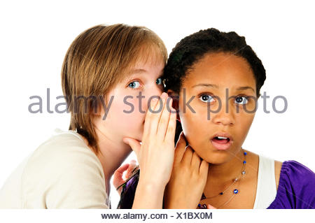 gossip whispering girlfriends - Stock Photo