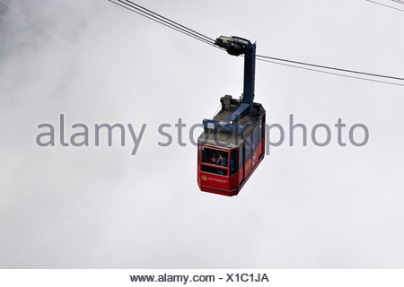 Gondola cableway to Mount Pilatus emerging from a sea of fog, Mount Pilatus, a recreational mountain at Vierwaldstaettersee, La - Stock Photo