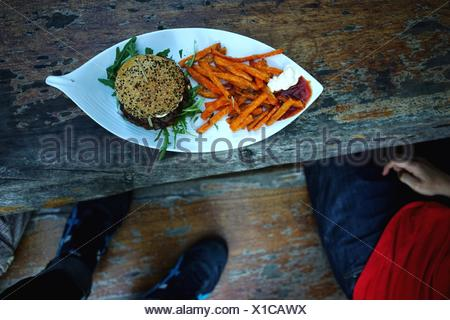 High Angle View Of Fries And Ham Burger - Stock Photo