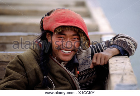 Handsome AMDO MAN sits in a boat as we cross the BRAMAHAPUTRA RIVER also know as the YARLUNG TSAMPO to SAMYE MONASTERY, China, Tibet - Stock Photo
