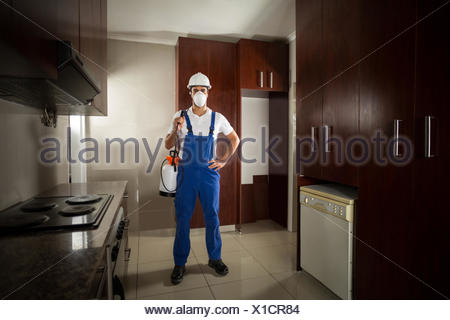 Portrait of pesticide worker with hand on hip - Stock Photo