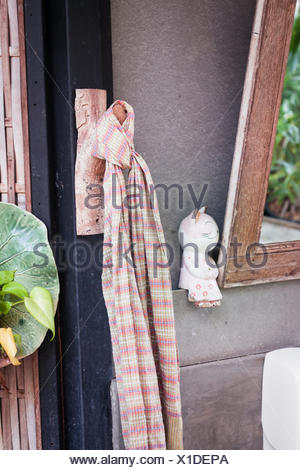 Clean cotton napkin in front of toilet - Stock Photo