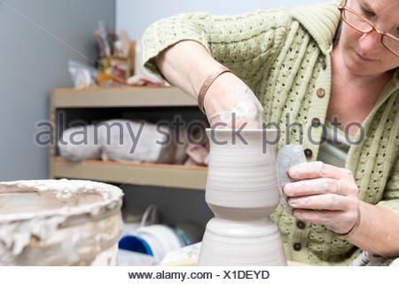 Potter working in studio - Stock Photo