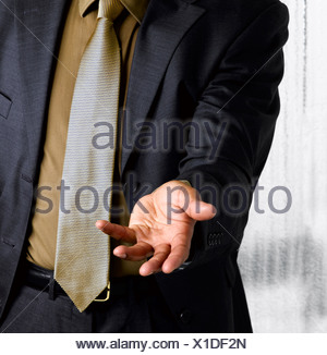 Business man with open hand out - Stock Photo
