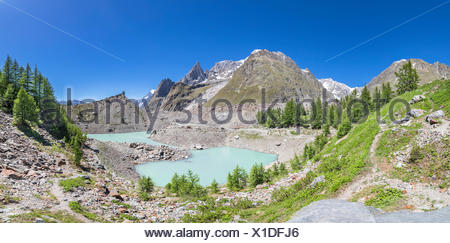 Panoramic view of the Mont Blanc Massif from the Miage Lake (Miage Lake, Veny Valley, Courmayeur, Aosta province, Aosta Valley, Italy, Europe) - Stock Photo