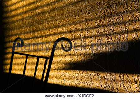 Shadows from window cast on wall - Stock Photo
