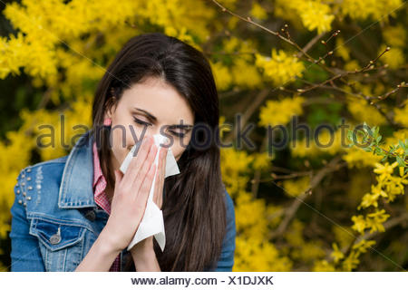 young woman with Allergic rhinitis - Stock Photo