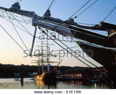 Tall Ships; Bow Of A Ship With Another Tall Ship In The Distance - Stock Photo