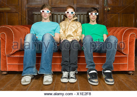 Three teenagers wearing 3d glasses - Stock Photo