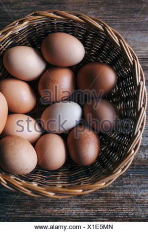 Organic eggs in a basket - Stock Photo
