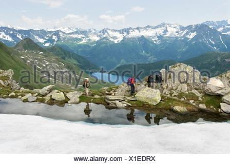 trekkers above Tom et Ritom lakes, Val Piora, Canton Ticino, Switzerland, Europe - Stock Photo