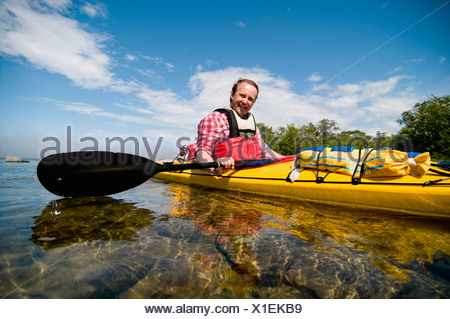 Man in kayak - Stock Photo