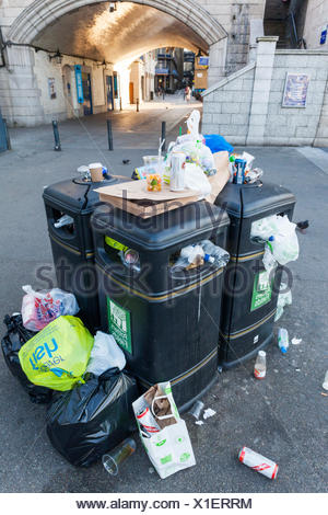 England, London, Over Flowing Rubbish Bin - Stock Photo