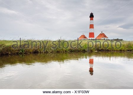 Westerheversand Lighthouse on the Eiderstedt Peninsula, with a reflection, North Frisia, Schleswig-Holstein, Germany, Europe - Stock Photo