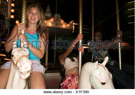 Friends on carousel - Stock Photo
