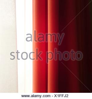 Cropped Orange And White Curtains On Window In House - Stock Photo