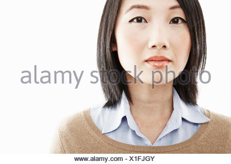 Close up studio portrait of young woman - Stock Photo