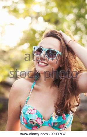 Young woman wearing sunglasses, portrait - Stock Photo