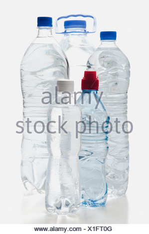 Close-up of assorted bottles of water - Stock Photo