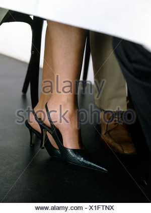 woman s legs under table in restaurant Stock Photo 4274666 Alamy