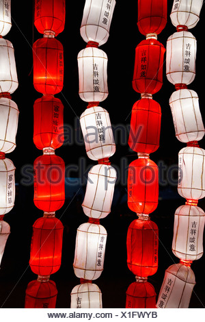 Red And White Chinese Lanterns Saying 'good Luck' In The Chinese Language; Chiang Mai Thailand - Stock Photo