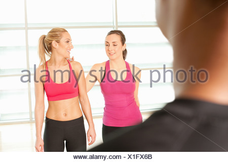 Women standing together in exercise class - Stock Photo