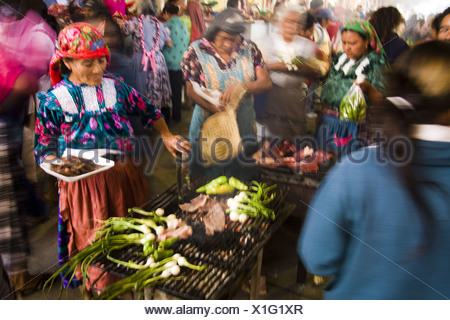 Zapotec women grill meat and vegetables at the weekly market of Tlacolula, Oaxaca, Mexico. - Stock Photo