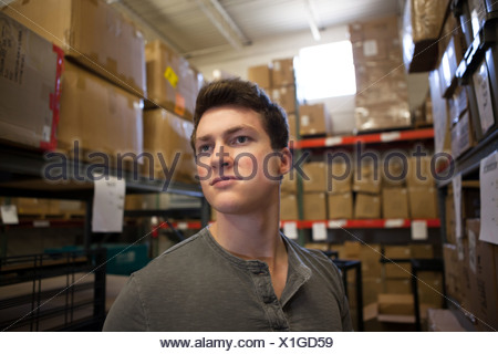 Worker standing in warehouse - Stock Photo