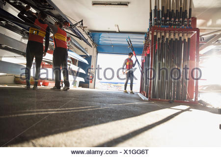 Rowers in boathouse - Stock Photo