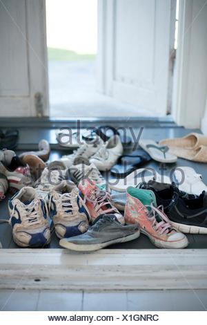 Sweden, Gotland, Shoes in hallway - Stock Photo