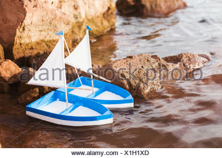 two toy boats in the sea - Stock Photo
