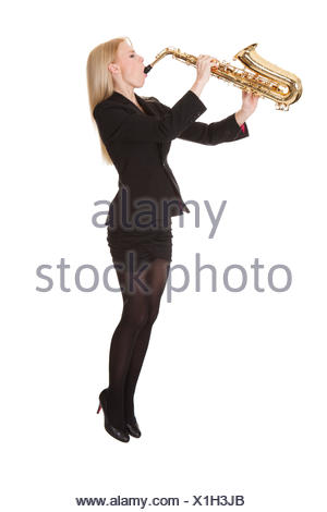 Beautiful young woman playing saxophone. Isolated on white - Stock Photo