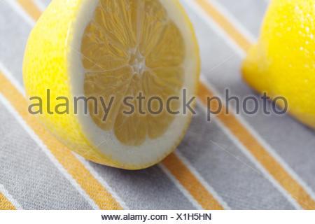 Lemon, halved, close up, - Stock Photo