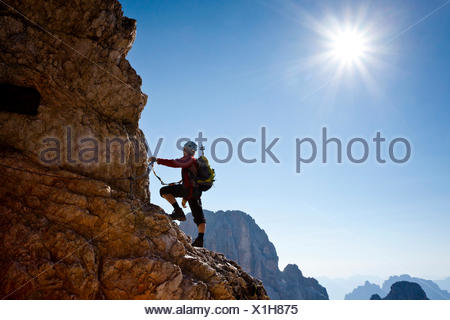 Mountain climber climbing the Marino Bianchi climbing route on Monte Cristallo to the summit of Cristallo di Mezzo, Dolomites - Stock Photo