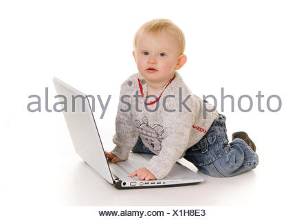 Young boy wih laptop - Stock Photo